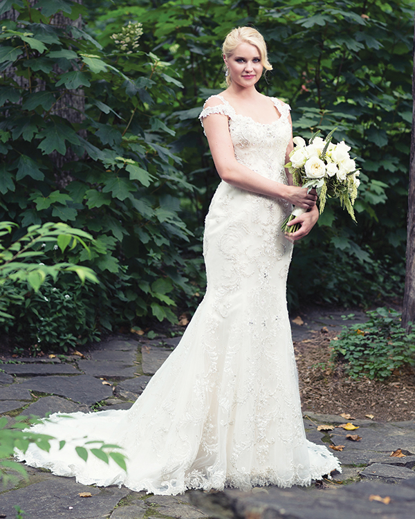 Ettiene gown by Sottero and Midgley Couture Collection, $2,398, from  Brides 2 Be by Hope Mitchell.  Valerie earrings, $49, from Brides 2 Be by Hope Mitchell.