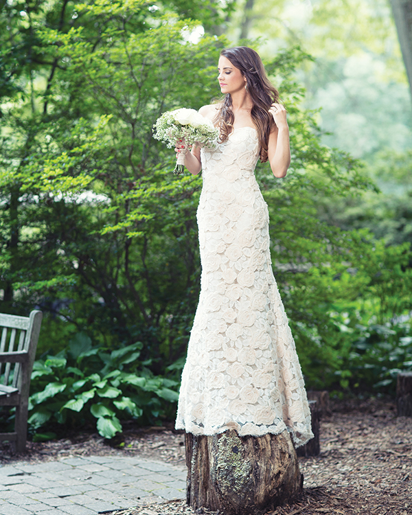 Eden gown by Modern Trousseau, $3,800, from Jennifer's Bridal.  Coin pearl earrings with sterling silver chain, $65, from Spoiled Girl Jewelry, Wilmington.  A bouquet of Tibet roses  and Queen Anne's lace, from  Ilonka Floral Decorator.