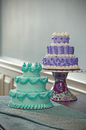 Little Cakes by Amy Hetrick of Cakewalk (funpartycakes.com). Floral cake stand by Two's Company, $87.50 at The Enchanted Owl, Greenville