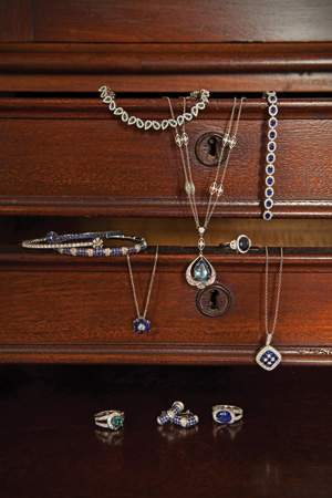 Top drawer: Blue diamond teardrop bracelet, $8,500 at Jeweler's Loupe, Dover. 18-karat white gold with aquamarine pendant, $17,700 at Stuart Kingston Jewelers, Wilmington. Gregg Ruth 18-karat white gold, sapphire-and-diamond bracelet, $7,000 at A.R. Morris Jewelers, Wilmington and Greenville. Second drawer: 18-karat white gold sapphire and diamond flexi-bangle with sapphire and diamonds, $4,950 at Stuart Kingston Jewelers. 18-karat white gold, sapphire-and-diamond bracelet, $4,500, and 14-karat white gold, sapphire-and-diamond necklace, $3,000 at A.R. Morris Jewelers. 18-karat white gold-and-sapphire ring with diamonds surrounded by a diamond halo from the OrStar Something Blue Collection, $4,985 at Orly Diamonds, Wilmington. Gregg Ruth 18-karat white gold, sapphire-and-diamond necklace, $3,400 at A.R. Morris Jewelers. Bottom row: blue diamond ring, $20,500 at Jeweler's Loupe, Dover. 18-karat white gold sapphire-and-diamond earrings, $2,100 at A.R. Morris Jewelers. 18-karat white gold, sapphire-and-diamond ring, $5,500 at A.R. Morris Jewelers