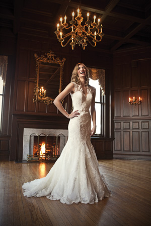 Spring 2012 Allure fitted lace gown with contoured straps that continue to a keyhole back, a chapel-length train and covered buttons. By Allure Bridal, $1,599 at Brides 2 Be, Lewes. Cubic zirconia earrings by Nova, $88 at Fantasia, Wilmington