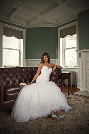 Organza over Chantilly lace mermaid gown with sweetheart neckline and tulle over lace skirt by Mori Lee, $798 at Candlight Bridal, Millsboro Hey Lady pumps, $280 at Jennifer's Bridal, Hockessin. Ivory- and-pearl clutch with rhinestone accents by Sondra Roberts, $179 at Fantasia, Wilmington. 14-karat white gold radiant-cut diamond ring with micro-pave diamond shank from the OrStar New Generation Collection, $5,985 at Orly Diamonds, Wilmington