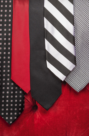 Black tie with white-and-red squares and solid red tie, both $79.50, from JoS. A. Bank Executive Collection, JoS. A. Bank, Greenville. Black silk tie by Bocara, $35; black-and-silver striped tie by Robert Talbott, $90; and black-and-white houndstooth tie in silk by Dion MCMLXXXIX, $105; all at Wright & Simon, Wilmington.
