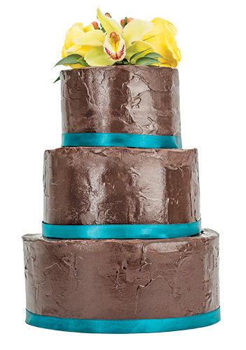 Oh, Fudge! Double chocolate truffle fudge mousse is glazed in ganache and topped with fresh flowers. <br>Nage Catering, 19730 Coastal Hwy., Rehoboth Beach, 226.2037, nagerb.com