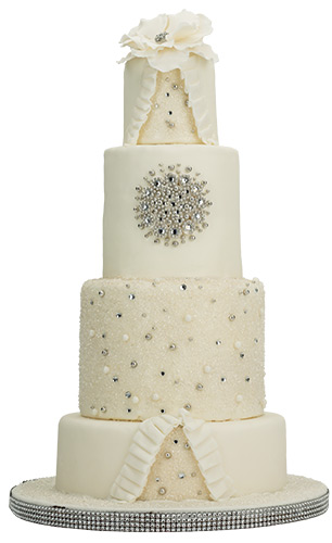 Silver Slice Fondant ruffles, crystal accents and silver dragées (sugar balls) add a touch of class. <br> Patty Cakes, 500 W. Loockerman St., Dover, 883.2491, pattycake.com