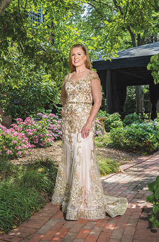 Evening Shade This Tony Bowls hand-beaded evening gown of embroidered mesh features illusion cap sleeves, an open-back bodice, embroidered hemline and a sweep train, $559, Lady's Image, Wilmington; bronze stone earrings, $59, Lady's Image; 1.63-carat diamond with a 14-karat white gold band, $8,690, Bellinger's Jewelers, Rehoboth Beach