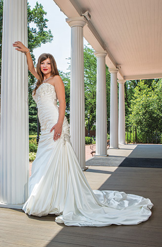 On the Veranda This Adeline Marie gown by Maggie Sottero features beading at the bodice, corset and side accent, $1,296, Anastasia's Bridal, Wilmington; Platinum diamond ring, $12,800, and Lauren G. Adams rhodium bangle bracelet with crystals, $155, Bellinger's Jewelers, Rehoboth Beach; Ella 151 necklace, Brides 2 Be by Hope Mitchell, Lewes