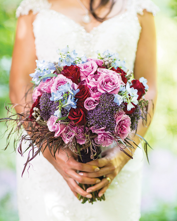 A bouquet of delphinium, floribunda roses, trachelium, agonis and brunia from  Petah Bashano Event & Floral Design, Broomall, Pa.
