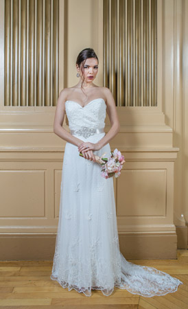 Ivory charmeuse makes a beautiful sheath. Beading and embroidery make a stunning overlay. The pleated bodice and a beaded belt at the natural waist finish the look perfectly. Gown by Tara Keely, $2,420, at Jennifer's Bridal, Hockessin; Clustered pearl earrings, $59, at Lady's Image, Wilmington; One-carat brilliant cut diamond in 14-karat gold features more than 1 carat of diamonds on the side, $11,250, at Bellinger's Jewelers, Rehoboth Beach.