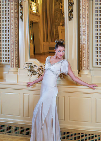 Sequins lend subtle sparkle to this ivory charmeuse gown by Sue Wong. The deep V neck adds drama. $419, at Lady's Image, Wilmington; Oval gold earrings with a mélange of pearls, $49, at Lady's Image, Wilmington; Ring from Bellinger's Jewelers, Rehoboth Beach.