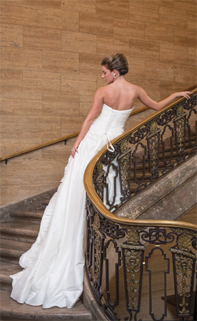 An organza insert and taffeta ruffles remove easily to transform this gown by Essense of Australia from pure glamour to beautifully simplistic. $1,498, at Fantasia  Bride, Wilmington. Silver-rhinestone earring and necklace set (necklace not pictured), $60, at Lady's Image, Wilmington.