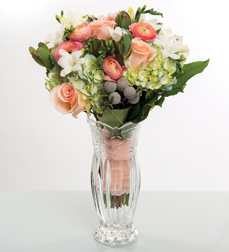 Peach roses and snorkel blue hydrangeas from Bloomsberry Flowers in Wilmington, Del.