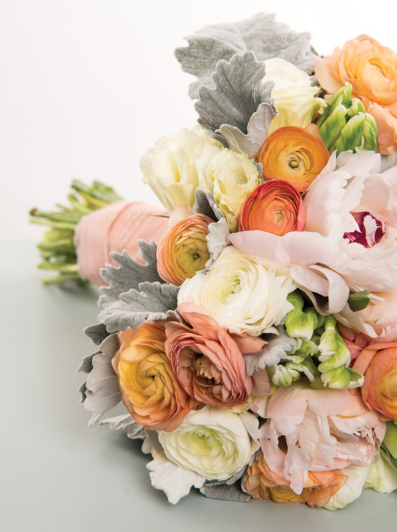 White and peach ranunculus,  white lisianthus and blush peonies from Flower Tales in Bala Cynwyd, Pa.