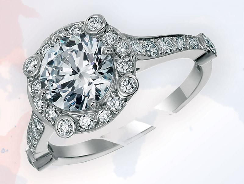 Platinum mounting combines classic bead setting with bezel set diamonds at the corners. Walter J. Cook Jeweler