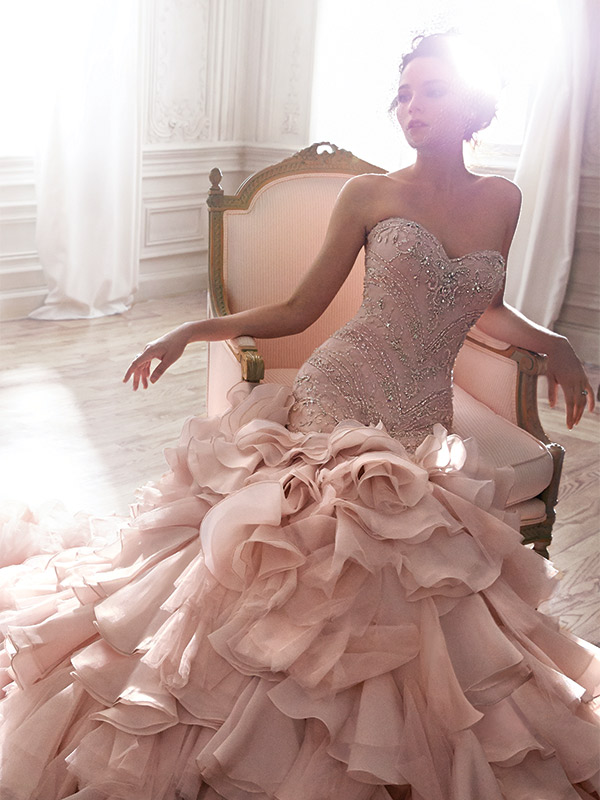 Maggie Sottero Serencia Mermaid fit with a tiered bottom. $2,400 at Bijou Bridal & Special Occasion, www.bijoubridal.com