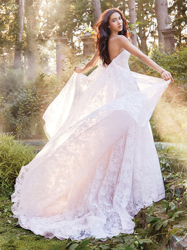 Uh oh, boho! The '70s are back, but these gowns are not for hippie girls. Think embroidery, tiered skirts and beading.  Ti Adora by Alvina Valenta, Style 8556. $2,000 at Jennifer's Bridal, Hockessin,www.jennifersbridal.com