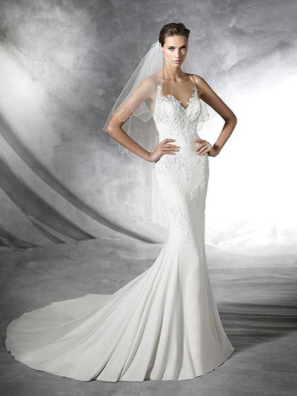 Classically Cool: Fit for the modern-day princess, but with a twist. Pronovias Plisa $1,750 at Bijou Bridal & Special Occasion, www.bijoubridal.com