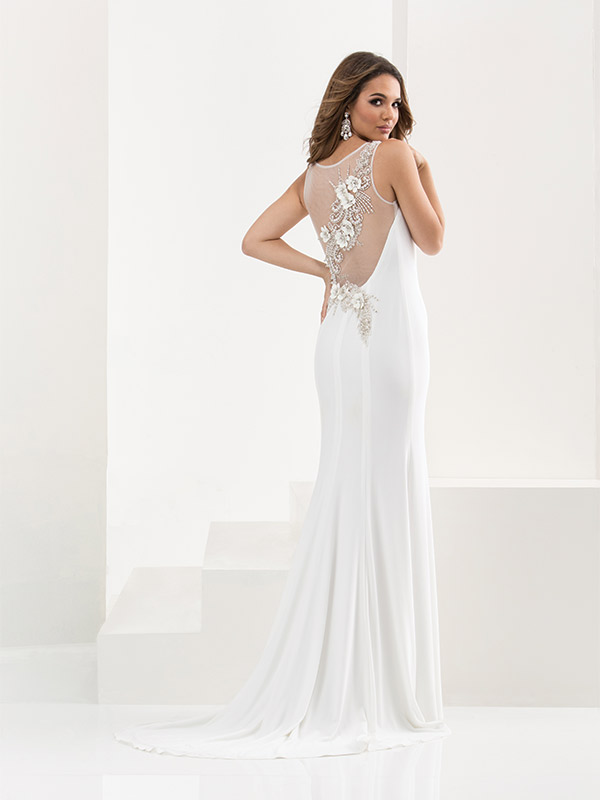 Jasz Couture, Style 5820. Matte jersey-pearls and appliqués delicately scattered on the back of the dress. $410 at Jan's Boutique, www.jansboutique.com