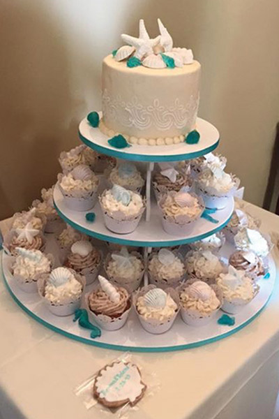 The seashell-themed cake and cupcakes