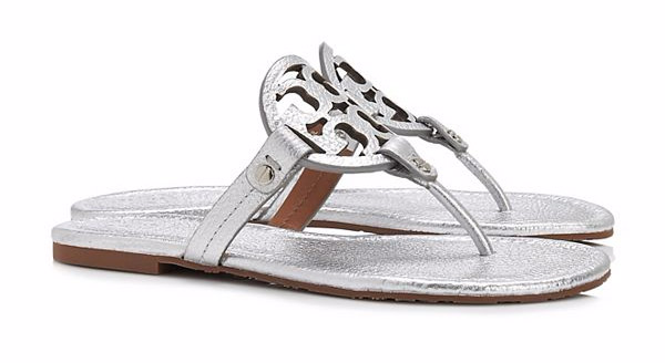 "Tory Burch Miller Sandal, Metallic Leather. $195. Available at <a href""https://www.toryburch.com/miller-sandal--metallic-leather/50008679.html?dwvar_50008679_color=040&cgid=shoes-sandals&start=50"">Tory Burch</a>."