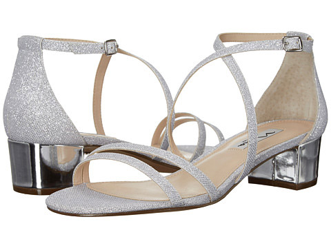 """NINA Genji Glitter Sandals. $48.58. Available at <a href=""""http://www.lordandtaylor.com/webapp/wcs/stores/servlet/en/lord-and-taylor/shoes/special-occasion-54154--1/genji-glitter-sandals"""">Lord & Taylor</a>."""