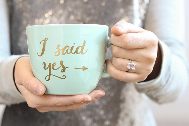 4. Swap the sign for a mug. Point out your rock while holding a cute cup.