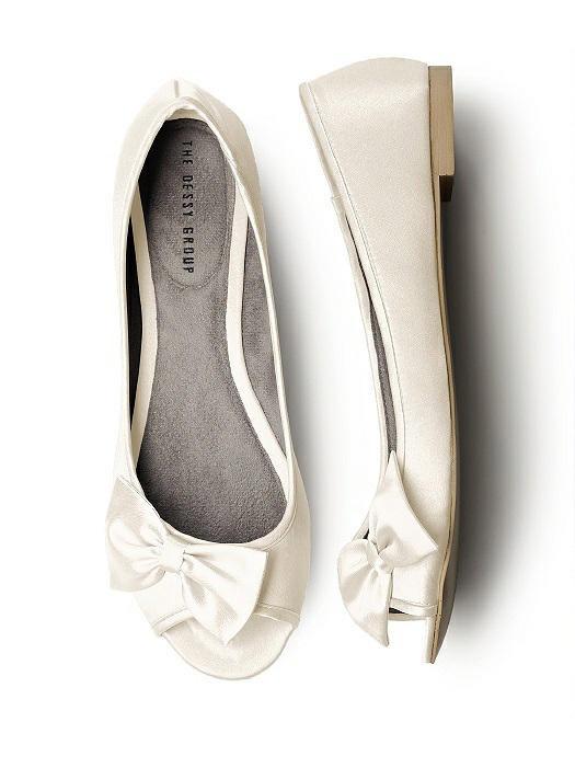 "The Dessy Group Satin Peep Toe Bridal Ballet Wedding Flats. $32. Available at <a href=""https://dessy.com/accessories/satin-peep-toe-bridal-ballet-flats/#.V7Nmn5ODGkq"">Dessy</a>."