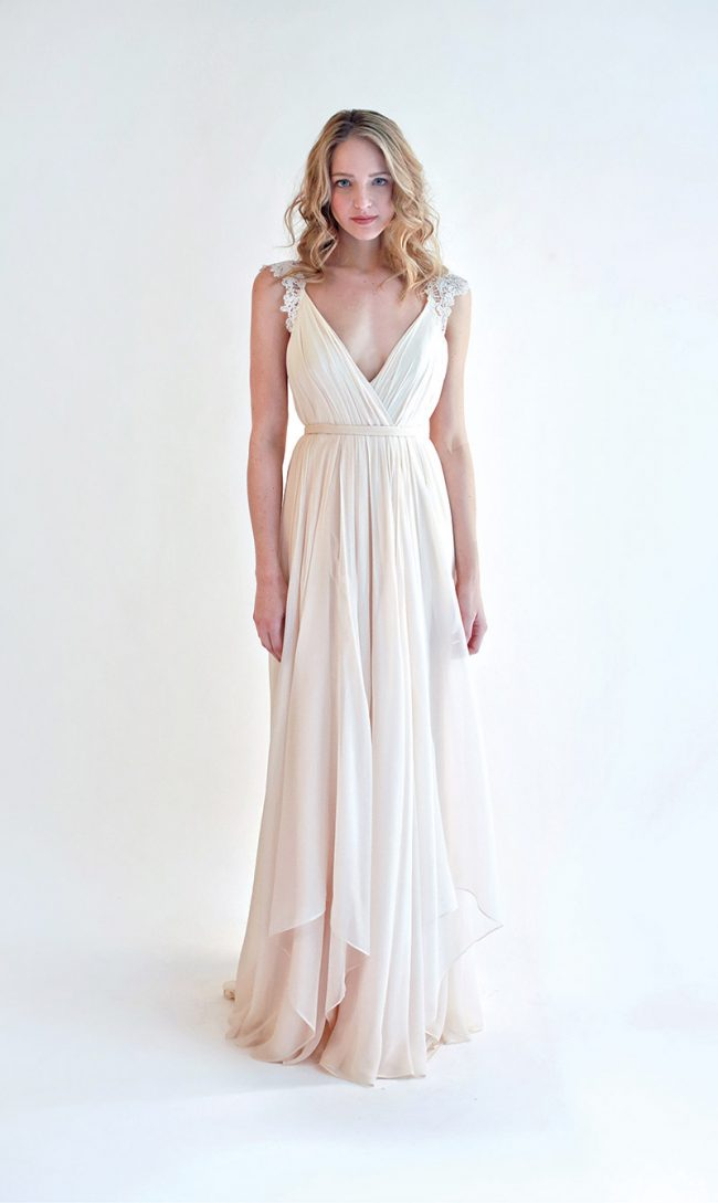 Leanne Marshall Style Lana: This light blush chiffon gown is ethereal, and will stop traffic from the front and the back. The ivory French lace straps add a delicate touch. Sample gown, size 10, priced at $1,850 (originally $3,690) at Sabrina Ann Couture, West Chester.