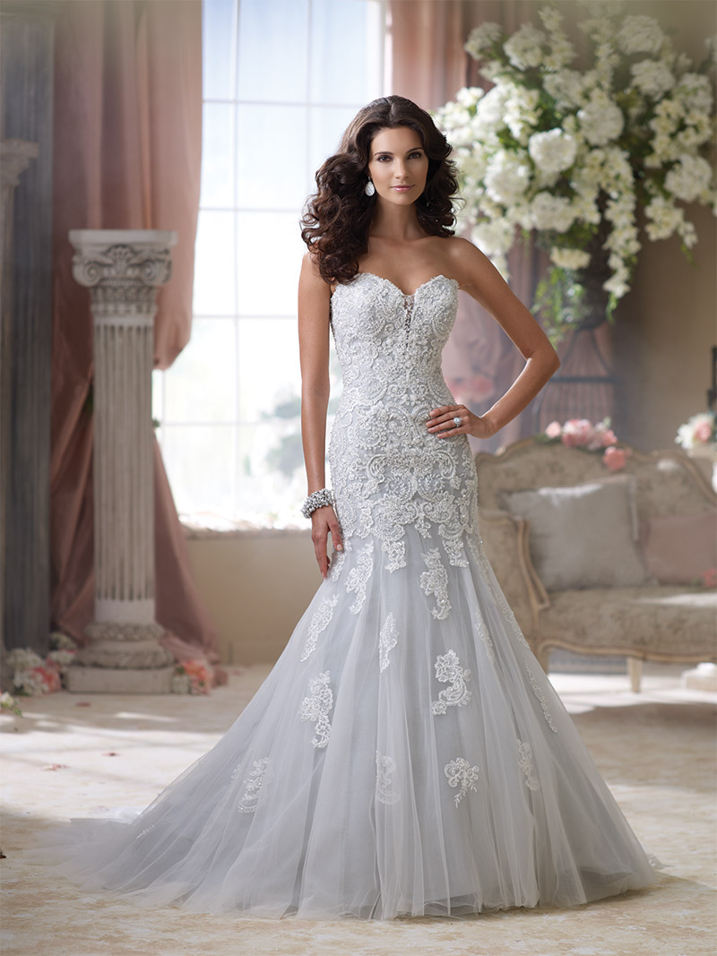 David Tutera for Mon Cheri Style 114293—Beryl: Enchanting sea mist strapless lace dress with embroidered lace and tulle over memory taffeta. $1,573 at Brides 2 Be By Hope Mitchell, Rehoboth Beach.