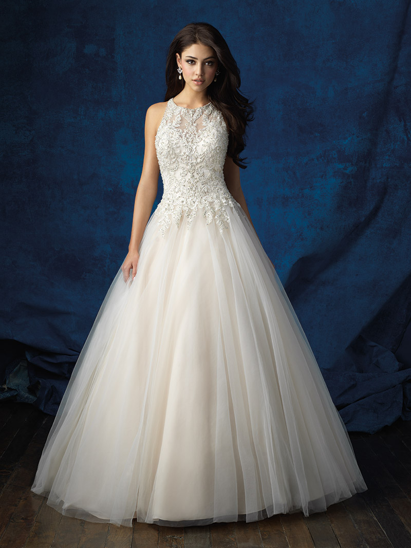 Allure Bridals Style 9359: This champagne regal ball gown features a high neck and elegant beadwork. $1,528 at Brides 2 Be By Hope Mitchell.