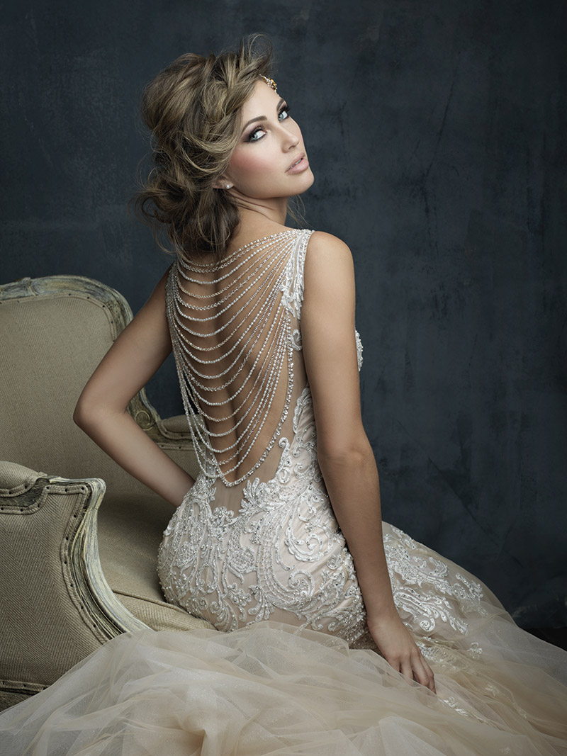 Allure Bridals Style C388: Sparkle in this antique gold gown that channels the glamour of the 1920s. $2,360 at Brides 2 Be By Hope Mitchell and Claire's Fashions.