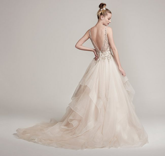 Maggie Sottero Midgley-Amelie: Dione organza creates the dramatic Amelie ball gown with horsehair layered skirt, featuring a bodice adorned with Swarovski crystals and pearls, plunging V-neckline and back. $2,249 at Brides 2 Be By Hope Mitchell.