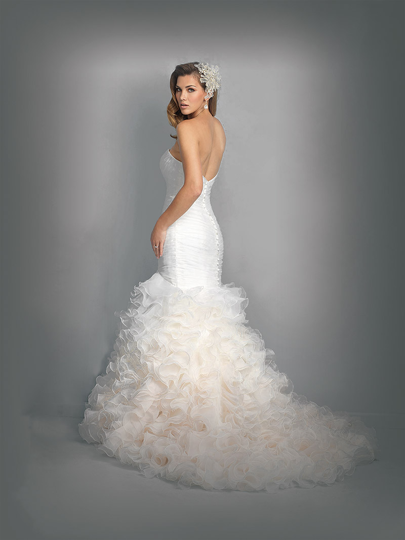 llure Bridals Style 9223: Softly ruched bodice trails to a playful ruffled skirt. $1,573 at Claire's Fashions, Wilmington.