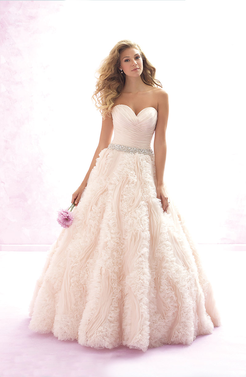 Madison James Bridal Style MJ120: Features gossamer ruffles and pleats throughout the bodice and skirt. $2,360 at Claire's Fashions.
