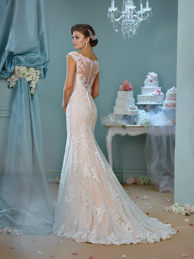 Enchanting by Mon Cheri Style 216159: Ivory/spun gold tulle gown with cap sleeves, lace back, scalloped hemline and chapel-length train. $920 at Occasions Boutique.