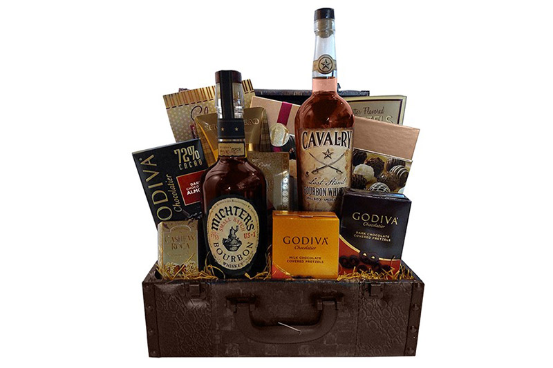 This basket includes a bottle of Cavalry Last Stand Bourbon Whiskey and Mitcher's US 1 Small Batch Bourbon. Chocolate and shortbread cookies accompany the gift.  $145, buildabasket.com