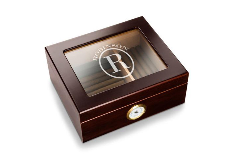 This mahogany Capri glass top humidor is an elegant gift. Add some cigars to complete the package.  $52.79, www.agiftpersonalized.com