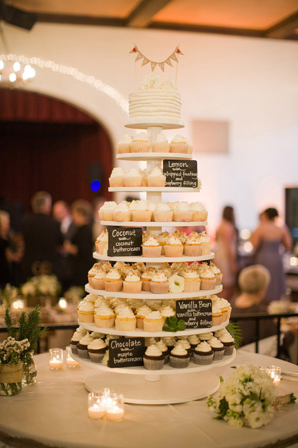 <strong> Cupcake Tower</strong> This cupcake tower from a rustic Santa Barbara, Calif. wedding includes an assortment of chocolate, vanilla, coconut and lemon flavored cupcakes. The embellished small cake topper adds a touch of tradition.