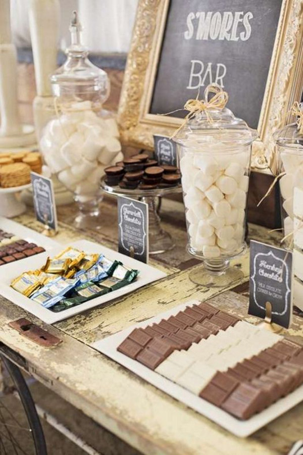 <strong>S'more's Station </strong> A s'mores station can be enjoyed no matter the wedding. Add some bite-sized pastries to take this culinary delight from campfire to wedding-worthy.