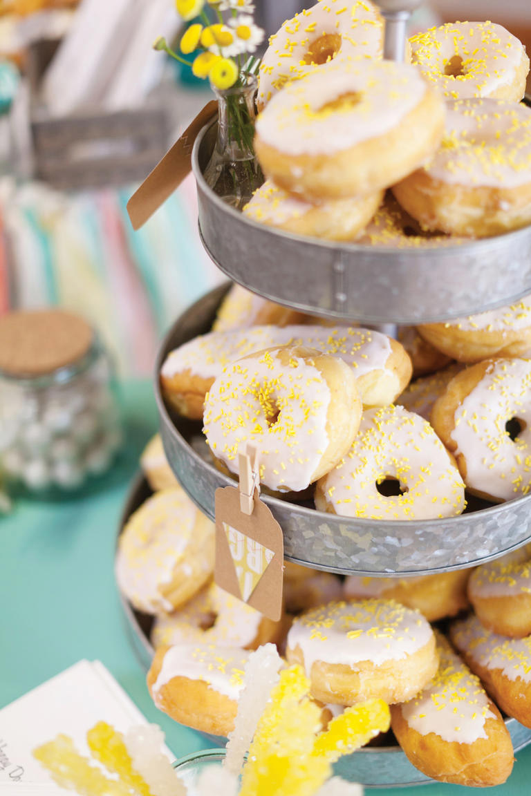 <strong>Donut Tower</strong> A donut tower is an easy and tasty alternative that is sure to be a crowd pleaser. This DIY wedding in Edwardsville, Ill. chose a yellow theme to coordinate with the flowers on the grooms suit.