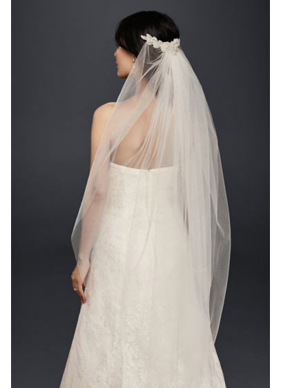 Every bride deserves to feel like a princess on her big day. Channel 1950's icon and real life princess Grace Kelly with a veil that skims just below the elbows, like this one from David's Bridal.