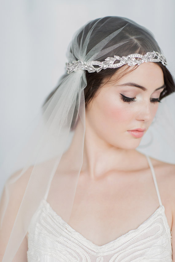 To veil or not to veil? A wedding look completed with the romantic headdress known as the Juliet cap, like this one from Blair Nadeau Millinery, will certainly not end in tragedy.