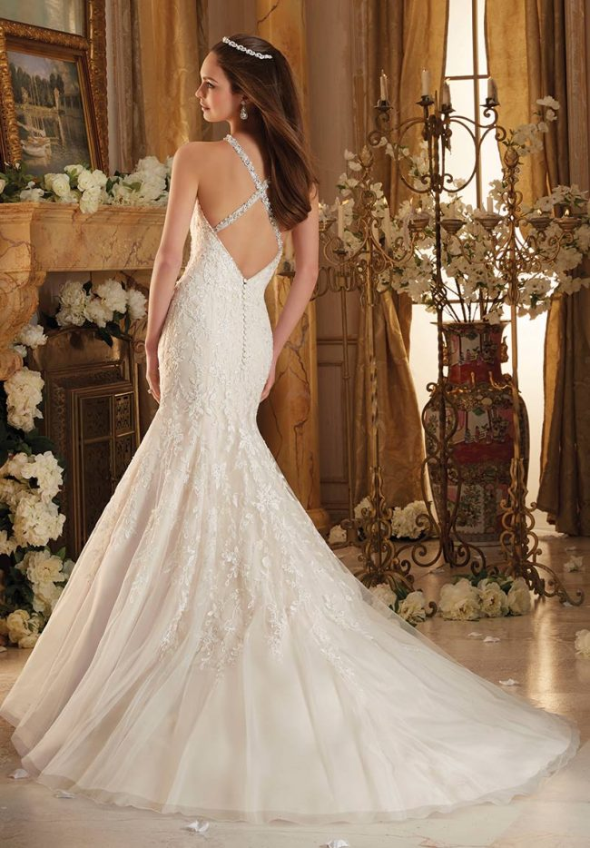 """(Mori Lee Bridal Style 8115) Fit-and-flare wedding dress features frosted Alencon lace appliques on net with an eye-catching wide scalloped hem line. Covered buttons accent the illusion back.  $1,299, <a href=""""www.thedressmatters.com"""">The Dress Matters</a>, Media, Pa."""