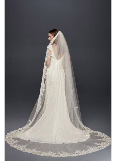 Princess Diana entered St. Paul's Cathedral in a 24-foot long veil. While you don't have to be royalty to be that level of glamour, you can make a dramatic walk down the aisle with a chapel-length veil, like this David's Bridal version, that cascades form the crown of the head to the floor.