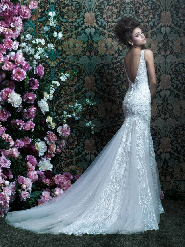 """(Allure Couture Style C415) Romantic lace applique drapes perfectly over silky charmeuse satin, highlighting a trailing overskirt. Both the neckline and back feature a deep V.  $3,260, <a href=""""www.clairesfashions.net"""">Claire's Fashions</a>, Wilmington, Del."""