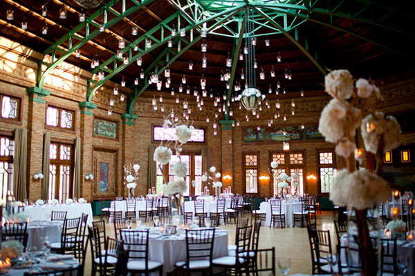 <strong>Suspended candles</strong> Give your venue a kiss of a mid-summer night's dream with candles that hang from the ceiling, or, if outdoors, the branches of tall floral arrangement or from the branches of trees. Place candles in mason jars for a whimsical tone.