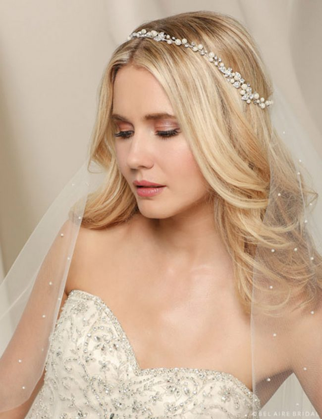 Don a lovely vine of soft pearls and twinkling rhinestone leaves. This gorgeous garland is secured with easy-wear satin ties. Bel Aire Bridal Style 6534, $149, Claire's Fashions, Wilmington, Del.