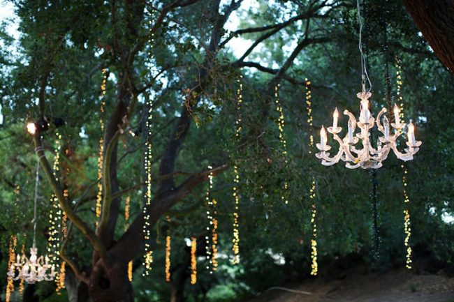 <strong>Outdoor chandeliers</strong> Hanging chandeliers above a sleek table setting dressed in white will make the décor pop even more. Or hang them from the trees for a glamorous spring or summer wedding.