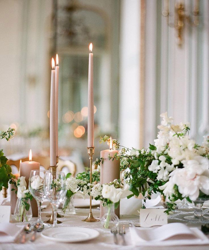 <strong>Taper candles</strong>  Tall, thin candles adorn the church aisle with class and rustic charm. They are understated and perfect for any wedding theme or venue.