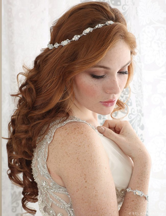 This graceful rhinestone and crystal halo will surround your locks with stunning shimmer. It is available in opal/silver or clear/silver. Bel Aire Bridal Style 6600, $189, Claire's Fashions, Wilmington, Del.